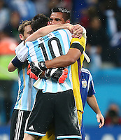 Argentina goalkeeper Sergio Romero celebrates with Linoel Messi after the penalty shoot out victory over the Netherlands