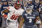Nevada running back Devonte Lee (2) runs away from New Mexico linebacker Erin Austin (90) in the first half of an NCAA college football game in Reno, Nev., Saturday, Nov. 2, 2019. (AP Photo/Tom R. Smedes)