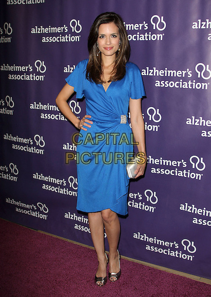 """Torrey DeVitto.20th Annual """"A Night At Sardi's"""" Fundraiser And Awards Dinner Held at The Beverly Hilton Hotel, Beverly Hills, California, USA..March 21st, 2012.full length blue dress hand on hip.CAP/ADM/KB.©Kevan Brooks/AdMedia/Capital Pictures."""