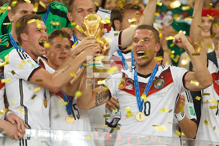 Lukas Podolski and Kevin Grosskreutz of Germany lift the World Cup trophy after winning the 2014 final