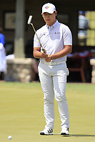 Si Woo Kim (KOR) on the practice green before starting his match during Sunday's Final Round of the 117th U.S. Open Championship 2017 held at Erin Hills, Erin, Wisconsin, USA. 18th June 2017.<br /> Picture: Eoin Clarke | Golffile<br /> <br /> <br /> All photos usage must carry mandatory copyright credit (&copy; Golffile | Eoin Clarke)