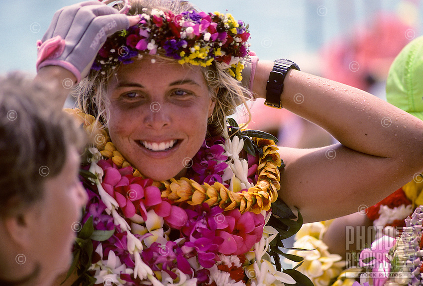 Outrigger canoe racing; paddler, Katie McCreary of Outrigger Canoe Club, at finish of Women's Molokai to Oahu Race, October 1989, Kahanamoku Beach, Waikiki, Oahu