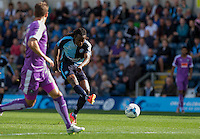 Marcus Bean of Wycombe Wanderers hits a shot at goal during the Sky Bet League 2 match between Wycombe Wanderers and Plymouth Argyle at Adams Park, High Wycombe, England on 12 September 2015. Photo by Andy Rowland.
