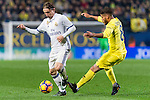 Luka Modric (l) of Real Madrid battles for the ball with Jonathan Dos Santos of Villarreal CF during their La Liga match between Villarreal CF and Real Madrid at the Estadio de la Cerámica on 26 February 2017 in Villarreal, Spain. Photo by Maria Jose Segovia Carmona / Power Sport Images