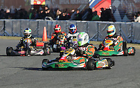 A group of kart racers dive into the first turn at the start of a race in a go-cart race at Daytona International Speedway on Tuesday, December 29, 2007. (Photo by Brian Cleary/www.bcpix.com)