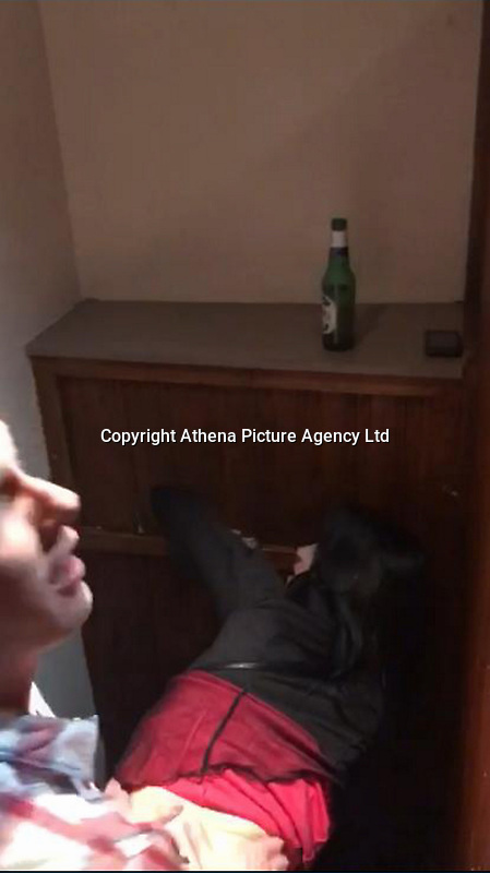 Pictured: A video grab showing a man and and a woman have sex in a toilet cubicle in Swansea, Wales on Christmas Eve. 24 December 2016<br /> Re: A video showing two DVLA workers having sex in a disabled toilet cubicle during their Christmas party in Swansea, Wales, UK