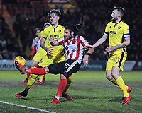 Lincoln City's Michael Bostwick vies for possession with Cheltenham Town's Joe Rodon, left and Cheltenham Town's Carl Winchester<br /> <br /> Photographer Andrew Vaughan/CameraSport<br /> <br /> The EFL Sky Bet League Two - Cambridge United v Lincoln City - Friday 9th February 2018 - Abbey Stadium - Cambridge<br /> <br /> World Copyright &copy; 2018 CameraSport. All rights reserved. 43 Linden Ave. Countesthorpe. Leicester. England. LE8 5PG - Tel: +44 (0) 116 277 4147 - admin@camerasport.com - www.camerasport.com