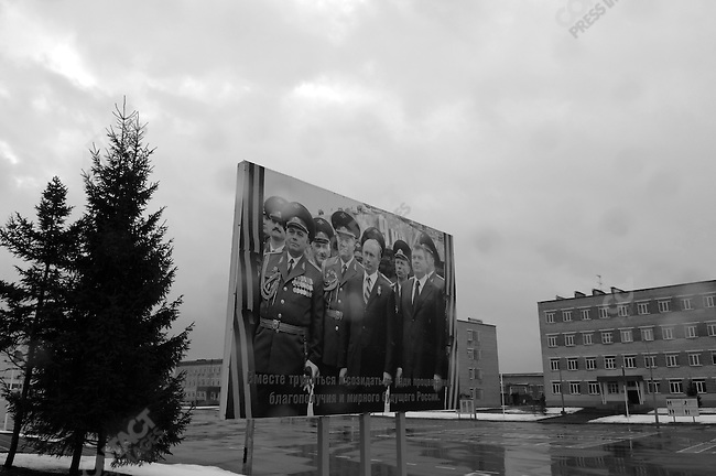 At the base of the Tamansky Motorised Infantry Division where Dimitri Medvedev, a candidate in the upcoming Russian presidential elections, came to mark the holiday of the Defender of the Fatherland, and to talk to a group of officers about their life in the army, a poster showing the current Russian president Vladimir Putin with commanding officers stood on the side of a parade ground. Moscow, Russia, February 23, 2008.