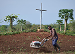 Moses Ganiko plows a field on a church-sponsored farm in Riimenze, South Sudan. The farm is run by Solidarity with South Sudan and provides food for students at a teacher training college, residents of a Congolese refugee camp, and displaced South Sudanese who live in a camp for internally displaced persons that formed around the Our Lady of Assumption Catholic Church in Riimenze.