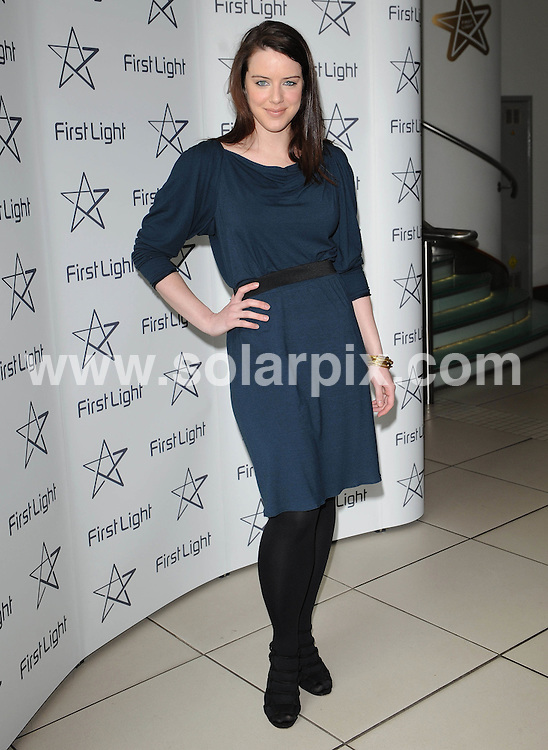 **ALL ROUND PICTURES FROM SOLARPIX.COM**                                             **WORLDWIDE SYNDICATION RIGHTS**                                                                                  Caption:  The First Light Movie Awards at Odeon Leicester square in London.                                                                             ..This pic:  Michelle Ryan                                                                                            ..JOB REF:12975        SSD       DATE: 15.03.2011                                                           **MUST CREDIT SOLARPIX.COM OR DOUBLE FEE WILL BE CHARGED**                                                                      **MUST AGREE FEE BEFORE ONLINE USAGE**                               **CALL US ON: +34 952 811 768 or LOW RATE FROM UK 0844 617 7637**