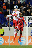 Mike Petke (12) of the New York Red Bulls and Collins John (15) of the Chicago Fire go up for a header during the second half of a Major League Soccer match between the New York Red Bulls and the Chicago Fire at Red Bull Arena in Harrison, NJ, on March 27, 2010. The Red Bulls defeated the Fire 1-0.
