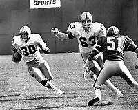 Oakland Raiders Mark van Eeghen with blocker Gene Upshaw against the Denver Broncos Bob Swenson, 1975 (photo/Ron Riesterer)