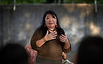 Joenia Wapichana speaks to a community gathering in Boa Vista, the capital of Brazil's Roraima State. She is the first indigenous lawyer in Brazil and the first indigenous woman elected to the Chamber of Deputies. She is a member of the Wapixana tribe of northern Brazil.