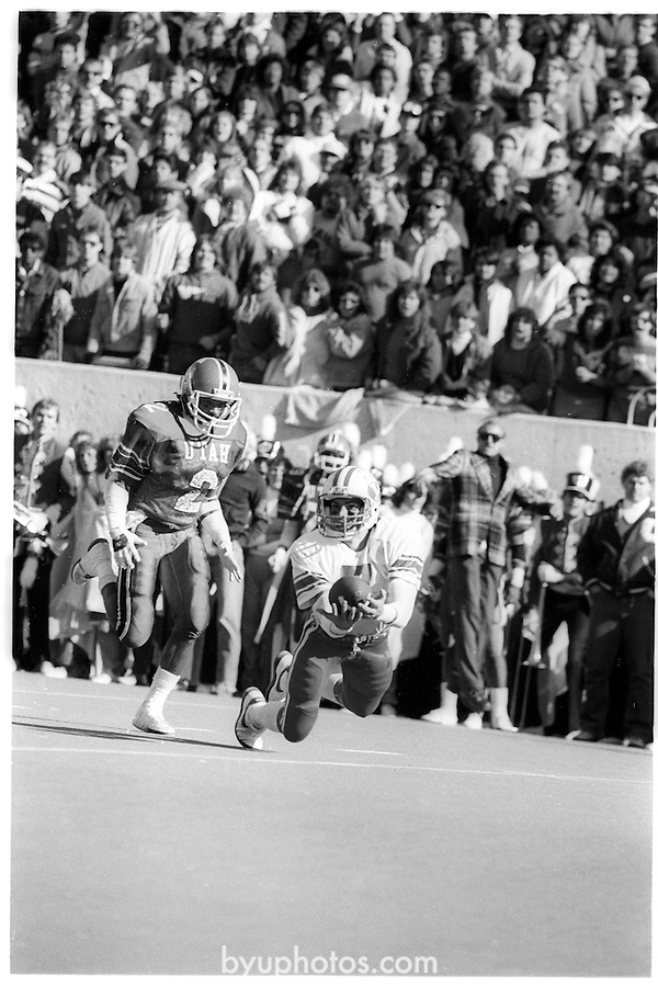 FTB 710 O 7A<br /> <br /> Football BYU at the University of Utah (U of U). 7 Glen Kozlowski making a diving catch.<br /> <br /> November 17, 1984<br /> <br /> Photo by Mark Philbrick/BYU<br /> <br /> &copy; BYU PHOTO 2009<br /> All Rights Reserved<br /> photo@byu.edu  (801)422-7322
