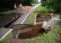 NWA Democrat-Gazette/ANDY SHUPE<br /> Engineers and workers with the Arkansas Department of Transportation survey Friday, June 7, 2019, the area around a bridge on Arkansas 265 in Hogeye after the creek it spans washed away the roadbed during heavy rains Thursday evening. The highway is closed south of the Arkansas 156 intersection.