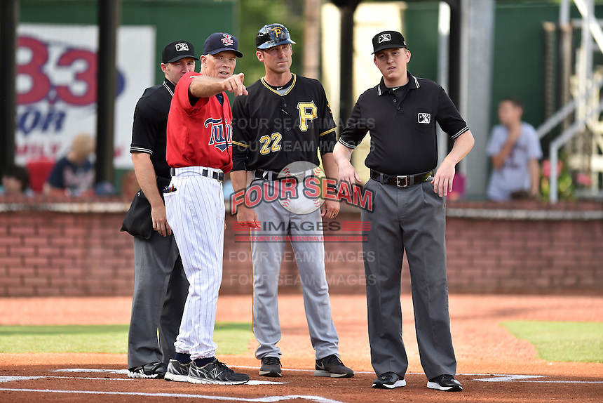 Home plate umpire Mark Stewart Jr., Elizabethton Twins manager Ray Smith (2) Bristol Pirates manager Kory DeHaan (22) and umpire Grant Hinson discuss the ground rules before a game between the Pirates and Twins at Joe O'Brien Field on July 30, 2016 in Elizabethton, Tennessee. The Twins defeated the Pirates 6-3. (Tony Farlow/Four Seam Images)