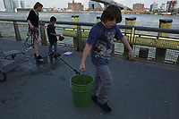 New York, NY, USA - June 21, 2017: Lower East Side Ecology Center and BioBus with teachers Kaitlyn Parkins and Mollie Thurman at the East River Fire Boat House. With Noam Blumenfeld, Aimee Carrasco, Miles Ellman, Cailynn Jacquez, Henry Jasper, Sebi Roko, Seiji Jasper, and William Carrasco. Final day of class with inspection of traps made by children, microscope work, and fishing.