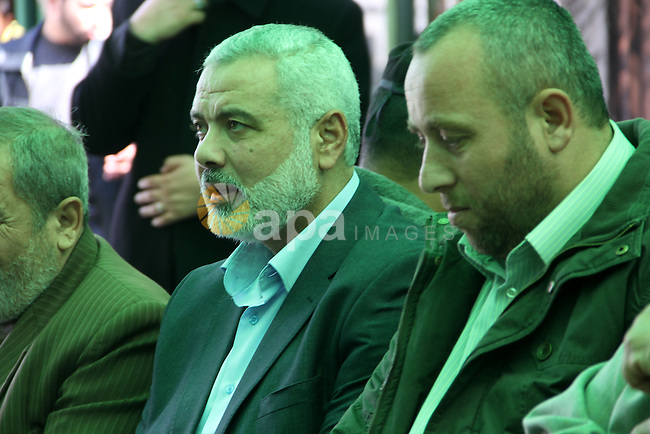 A handout picture dated February 26, 2014 and released by Hamas Press Office on August 21, 2014, shows the senior Hamas commander, Raed al-Atar (R), with the top Hamas official in Gaza Ismail Haniya (L) in the southern Gaza Strip town of Rafah. Three senior Hamas commanders, including al-Atar, were among at least 15 Palestinians killed in Gaza early on August 21, as Israel stepped up air strikes on day 45 of the bloody conflict. The Brigades, the military wing of Hamas which holds de facto power in Gaza, identified the three as Mohammed Abu Shamala, Raed al-Atar and Mohammed Barhum. APAIMAGES / HO / HAMAS PRESS OFFICE