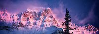 First light on mountain, surrounding Moraine lake with fresh snow. Banff National Park, Alberta, Canada