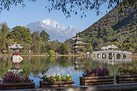 Jade Dragon Snow Mountain forms the backdrop to Black Dragon Pool in the outskirts of Lijiang, Yunnan province.