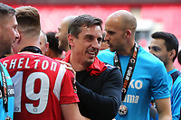 Gary Neville celebrates on the pitch with the players and staff as Salford City win promotion to the Football League during AFC Fylde vs Salford City, Vanarama National League Football Promotion Final at Wembley Stadium on 11th May 2019