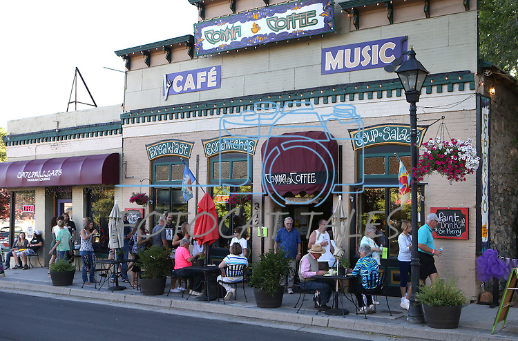 Crowds move through Comma Coffee during the 20th annual Taste of Downtown event in Carson City, Nev., on Saturday, June 15, 2013. The event features 44 local restaurants in a fundraiser for the Advocates to End Domestic Violence.<br /> Photo by Cathleen Allison