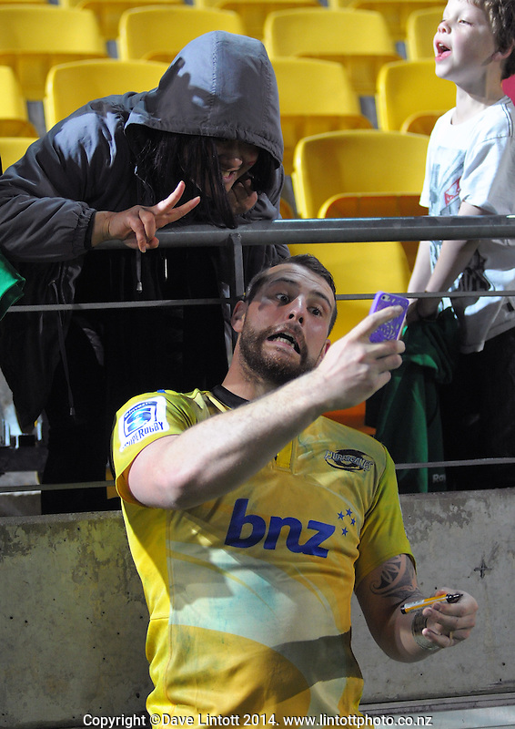 Blade Thomson poses for a selfy with a fan after the Super Rugby match between the Hurricanes and Crusaders at Westpac Stadium, Wellington, New Zealand on Saturday, 28 June 2014. Photo: Dave Lintott / lintottphoto.co.nz
