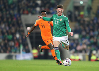 16th November 2019; Windsor Park, Belfast, County Antrim, Northern Ireland; European Championships 2020 Qualifier, Northern Ireland versus Netherlands; Jordan Thompson of Northern Ireland brings the ball forward past Netherland's Quincy Promes - Editorial Use