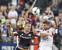 New England Revolution substitute forward Chad Barrett (9) and D.C. United midfielder Perry Kitchen (23) battle for head ball.  In a Major League Soccer (MLS) match, the New England Revolution (blue) tied D.C. United (white), 0-0, at Gillette Stadium on June 8, 2013.