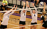 SIOUX FALLS, SD - SEPTEMBER 23: Michelle Ritland #12, Samantha Lovell #17, and Emily Johnson #8 from University of Sioux Falls looks look for a block against Alyssa Frauendorfer #10 from Wayne State Tuesday night at the Stewart Center.  (Photo by Dave Eggen/Inertia)