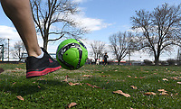NWA Democrat-Gazette/J.T. WAMPLER Jesus Pascual of Springdale kicks a ball to his son Pedro Pascual, 9, Monday March 19, 2018 at Luther George Park in Springdale. The park, located near downtown, features pavilions, exercise equipment, playgrounds, a skate park and open grass areas.