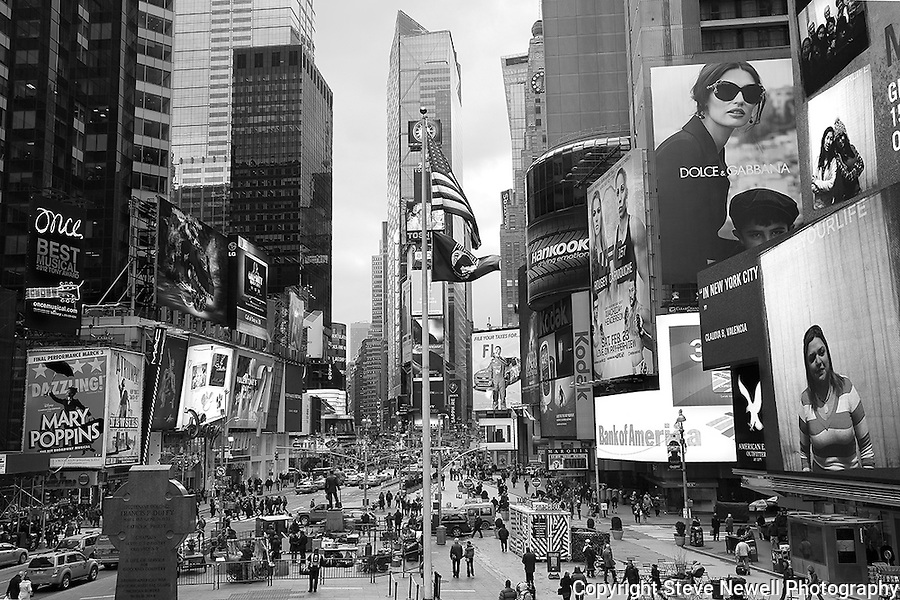 """The T Square"" Black and White Times Square Manhattan New York. Times Square is like a little city all to itself that provides plenty of entertainment, bars, restaurants, shopping and attractions for everyone.  You can't possibly do and see it all in a one week vacation. I went to two Broadway plays and one off broadway play while I was staying in Manhattan for eight days shooting photography.  The local employees recommended their favorite restaurants and bars in the area that were excellent and affordable.  Times Square has so much to offer everyone from all walks of life will be satisfied on a visit to the must see district. I made several trips to the area spanning morning noon and night- to late night. When the huge storm blew into New York on the weekend I found myself in the middle of Times Square alone enjoying the light snow fall.  A memory I will cherish!"