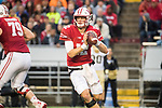 Wisconsin Badgers quarterback Alex Hornibrook (12) looks for a receiver during an NCAA College Big Ten Conference football game against the Purdue Boilermakers Saturday, October 14, 2017, in Madison, Wis. The Badgers won 17-9. (Photo by David Stluka)