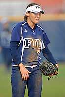 11 February 2012:  FIU's Kayla Burri (7) waits for the pitch as the University of Massachusetts Minutewomen defeated the FIU Golden Panthers, 3-1, as part of the COMBAT Classic Tournament at the FIU Softball Complex in Miami, Florida.