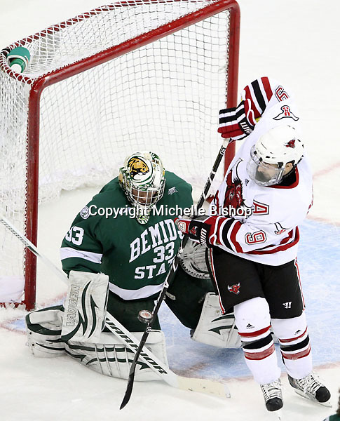 UNO's Rich Purslow tries to redirect a shot past Bemidji State goalie Dan Bakala. Bemidji State won 3-2 in overtime at Qwest Center Omaha. (Photo by Michelle Bishop)