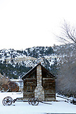USA, Utah, old cabin and wagon, Glendale, Hwy 89