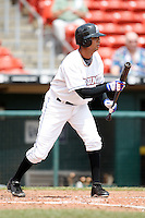 May 28, 2009:  Pitcher Nelson Figueroa of the Buffalo Bisons attempts a bunt during a game at Coca-Cola Field in Buffalo, NY.  The Bisons are the International League Triple-A affiliate of the New York Mets.  Photo by:  Mike Janes/Four Seam Images