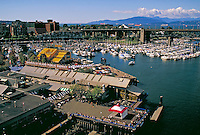 Overhead view of Granville Island in False Creek. Featuring Granville Island Public Market. City Center, Granville Bridge, Burrard Bridge, public market, market, tourism, tourist attraction. Vancouver British Columbia Canada.