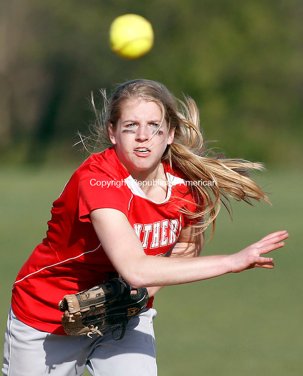 Southbury, CT-13 April 2012-041312CM08-  Pomperaug's Martha Stanko makes a throw to first for an out during their 4-1 win over Oxford Friday afternoon in Southbury.   Christopher Massa Republican-American
