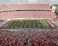 "Members of the Alumni Band and current members of the Ohio State Marching Band got together to form a ""quad"" Script Ohio during half time of the September 7, 2013 game against San Diego State.  (Chris Russell/Dispatch Photo)"