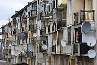 ROMANIA, 03.2009, Negresti Oas..Satellite dishes and balconys, Negresti Oas, Satu Mare county, Romania..© Egyed Ufo Zoltan / Est&Ost Photography