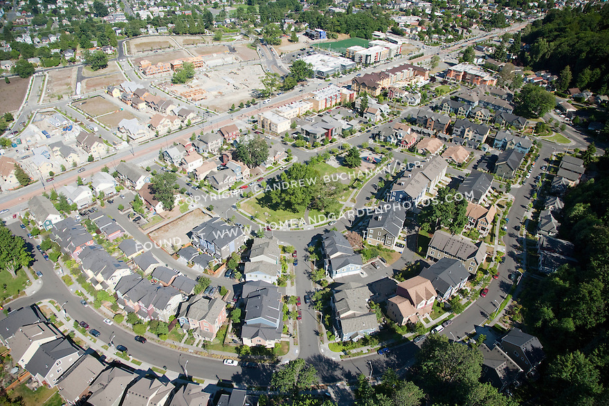 An aerial view of Rainier Vista, a mixed housing development in Seattle, WA with nearby SoundTransit light rail.