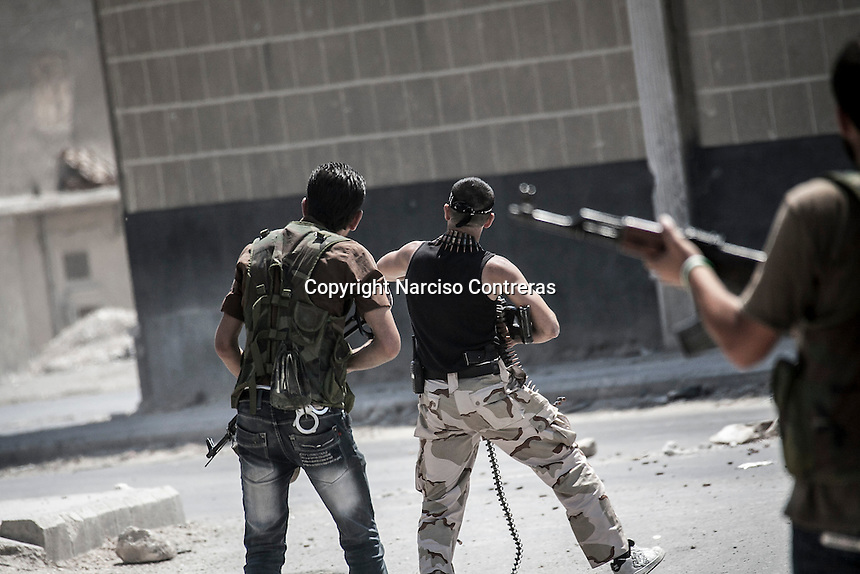 Free Army rebels fire with machine guns and Kalashnikovs as they repel an offensive attack by Assad's army during a battle in the neighborhood of Jaser Al Nerab. Intensive combats have taken place in the area under control of the rebels close to the airport to regain the position lost by the Assad's troops. .