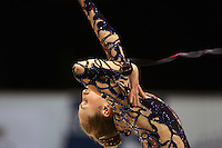 Inna Zhukova of Belarus re-catches ribbon during All-Around competition at 2006 Thiais Grand Prix in Paris, France on March 25, 2006.  (Photo by Tom Theobald)
