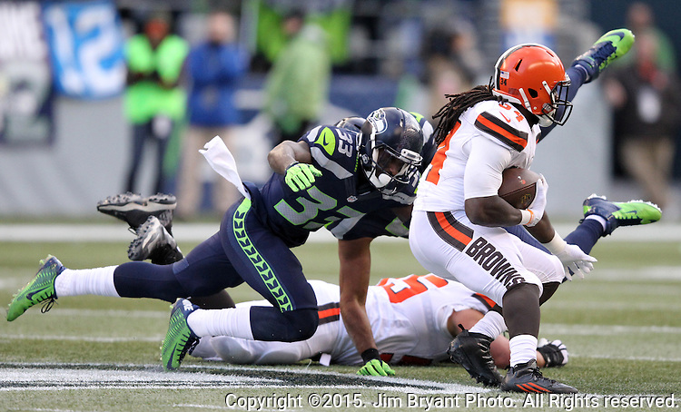 Seattle Seahawks strong safety Kelcie McCray (33) runs after Cleveland Browns running back Isiah Crowell (34) at CenturyLink Field in Seattle, Washington on December 20, 2015. The Seahawks clinched their fourth straight playoff berth in four seasons by beating the Browns 30-13.  ©2015. Jim Bryant Photo. All Rights Reserved.