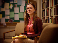 A counselor takes notes in her office while attending one of her group therapy sessions