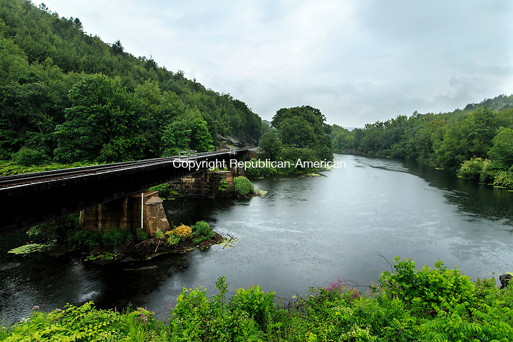 Waterbury, CT- 07 August 2017-080717CM04-  The Naugatuck River bends under a railroad trestle, as rain falls in Waterbury on Monday.  According to the National Weather Service, Tuesday is expected to clear up with partly sunny skies and a high near 79.      Christopher Massa Republican-American