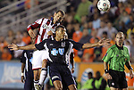 05 June 2012: Chivas USA's Alejandro Moreno (VEN) (above) heads the ball over Carolina's Amir Lowery (in blue). The Carolina RailHawks (NASL) lost 1-2 to Club Deportivo Chivas USA (MLS) at WakeMed Soccer Stadium in Cary, NC in a 2012 Lamar Hunt U.S. Open Cup fourth round game.