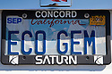 Close up of California 'ECO GEM' personalized license plate on Saturn Vue car. People pay for the customized plates and the proceeds support various causes. The fees collected for these Yosemite Foundation License Plates, featuring a famous view of Yosemite Valley and Half Dome, support the Yosemite Fund environmental projects.