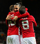 Zlatan Ibrahimovic of Manchester United celebrates with Wayne Rooney and Juan Mata after the opening goal during the UEFA Europa League match at Old Trafford, Manchester. Picture date: November 24th 2016. Pic Matt McNulty/Sportimage